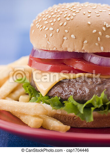 Cheese Burger in a Sesame Seed Bun with Fries - csp1704446