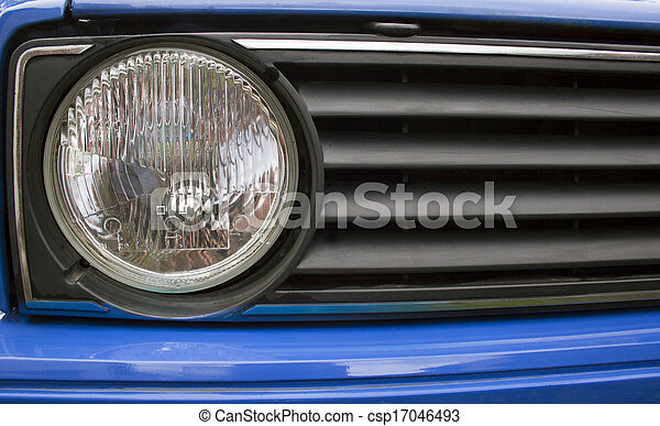 Close Up Old Of Automobile Grille And Headlight - csp17046493
