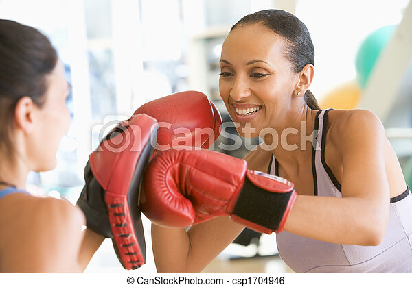 Women Boxing Together At Gym - csp1704946