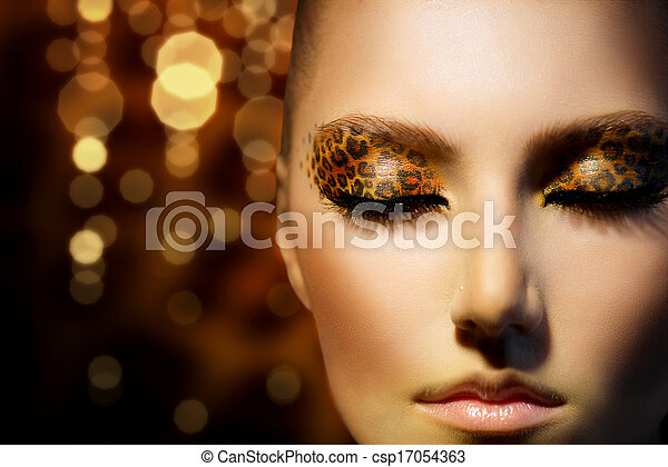 Beauty Fashion Model Girl with Holiday Leopard Makeup - csp17054363