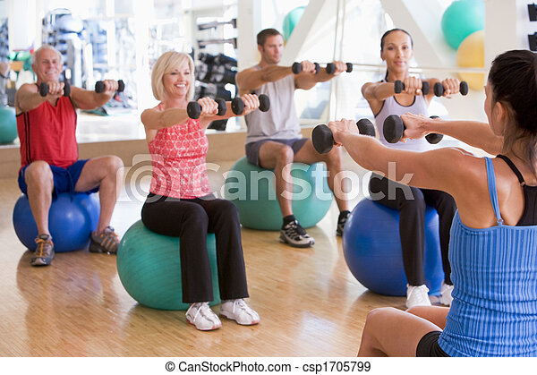 Instructor Taking Exercise Class At Gym - csp1705799
