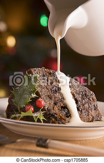 Portion of Christmas Pudding with Pouring Cream - csp1705885