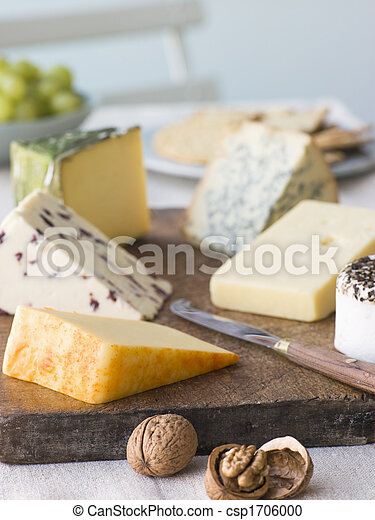 Selection of British Cheeses with Walnuts Biscuits and Grapes - csp1706000