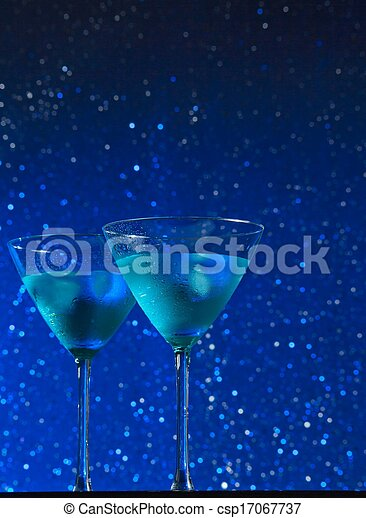 view from below of glasses of fresh blue cocktail with ice