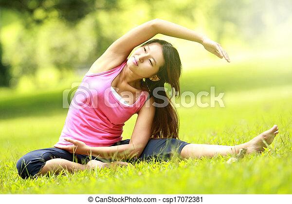 girl training on grass - csp17072381