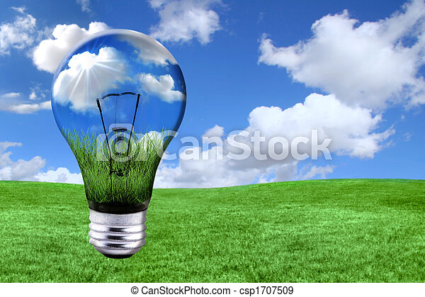 Green Energy Solutions With Light Bulb Morphed Into Landscape - csp1707509