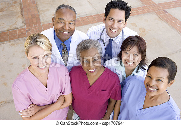 High Angle View Of Hospital Staff Standing Outside A Hospital - csp1707941