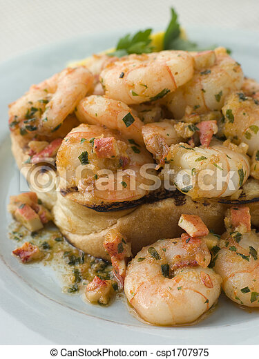 Toasted Brioche topped with Prawns cooked In Lobster Garlic Butter - csp1707975