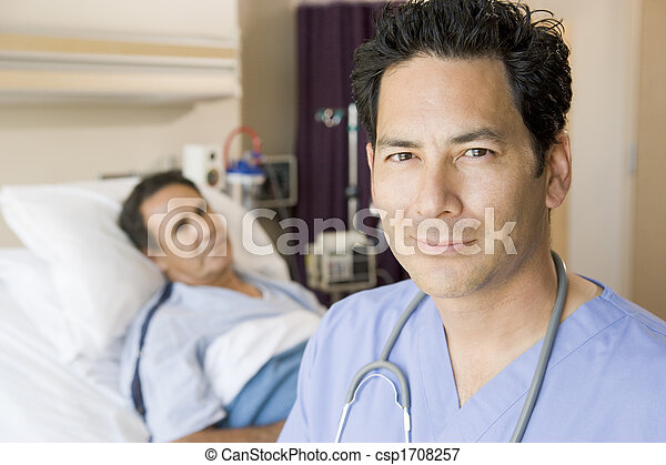 Doctor Standing In Patients Room - csp1708257