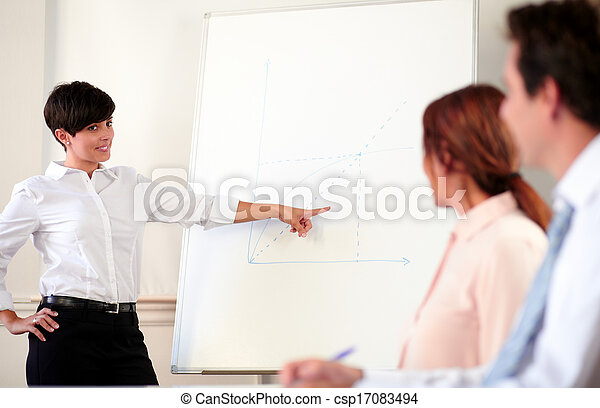 Young adult businesswoman giving a presentation - csp17083494