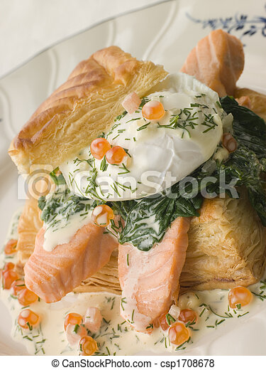 Seared Salmon Spinach and a Poached Egg in a Vol-au-Vent Case with a Dill and Keta Caviar Sauce - csp1708678