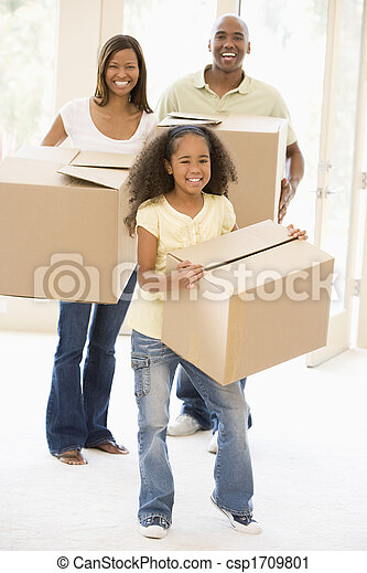 Family moving into new home smiling - csp1709801