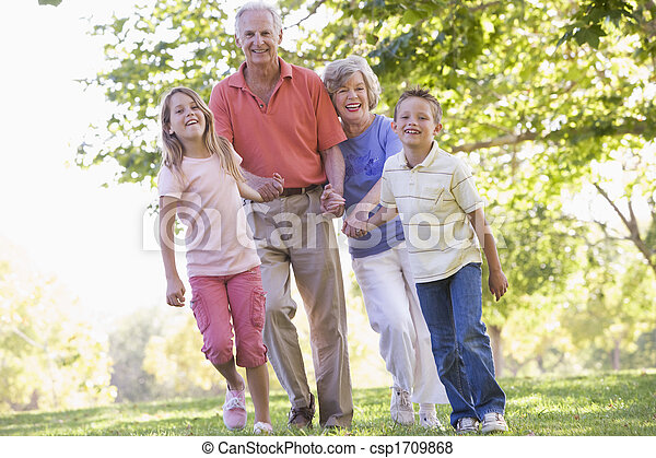 Grandparents walking with grandchildren. - csp1709868