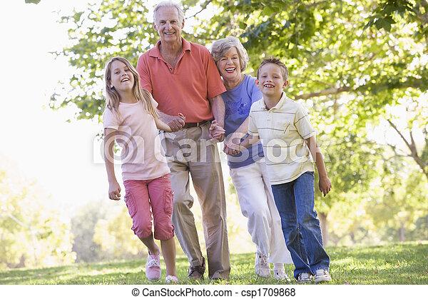 Grandparents walking with grandchildren. - csp1709868