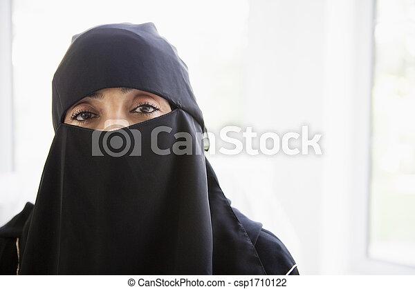 Woman wearing black veil indoors (high key) - csp1710122