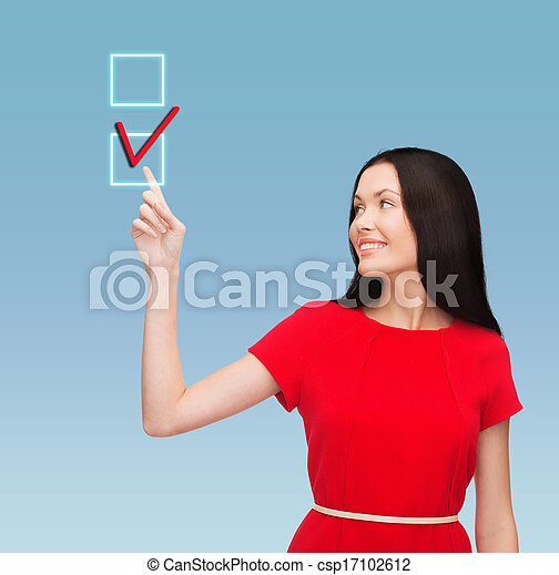 young woman in red dress pointing her finger - csp17102612