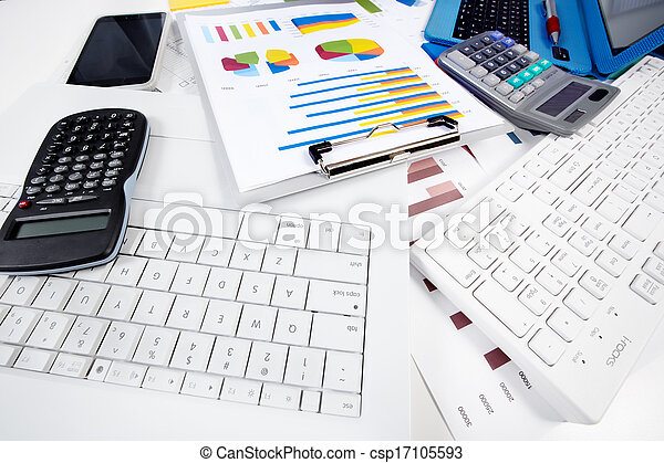Calculator and computer in the office. - csp17105593