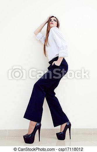 Fashion young business woman wearing man's shirt on white - csp17118012