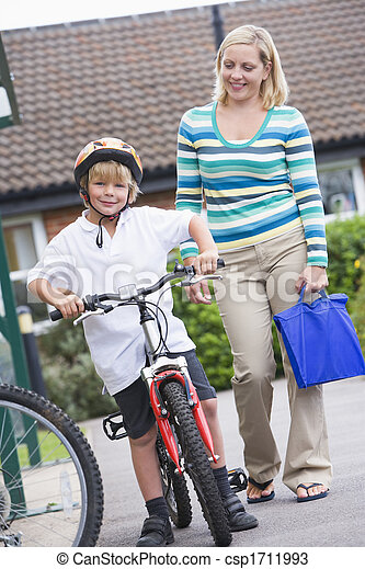 Mother and son outside school with bicycle - csp1711993