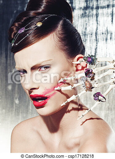 Surrealistic fashion portrait of a woman wearing jewellery  - csp17128218