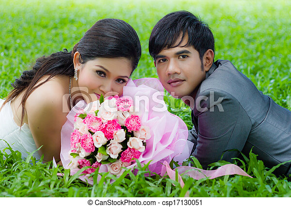 Couples of groom and bride with bouquet flowers - csp17130051