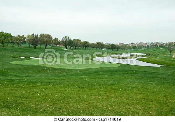 A bright green golf course - csp1714019