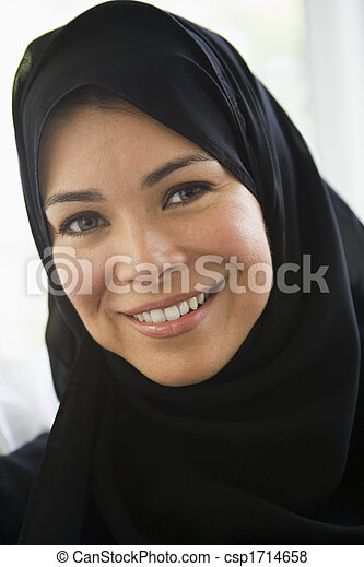 Woman standing indoors smiling (high key) - csp1714658