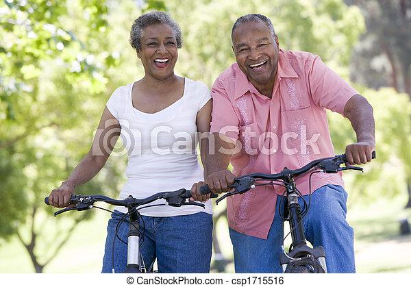 Senior couple on bicycles - csp1715516