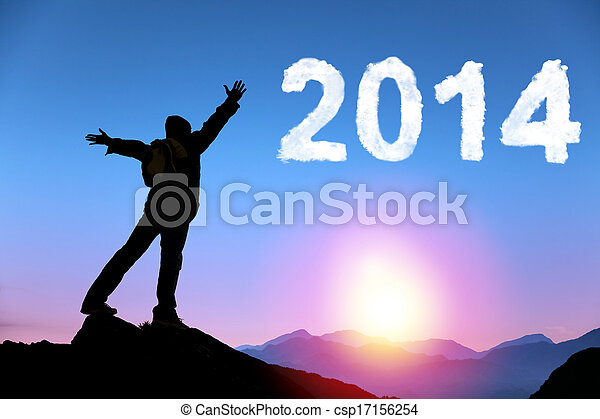 happy new year 2014.happy young man standing on the top of mountain - csp17156254