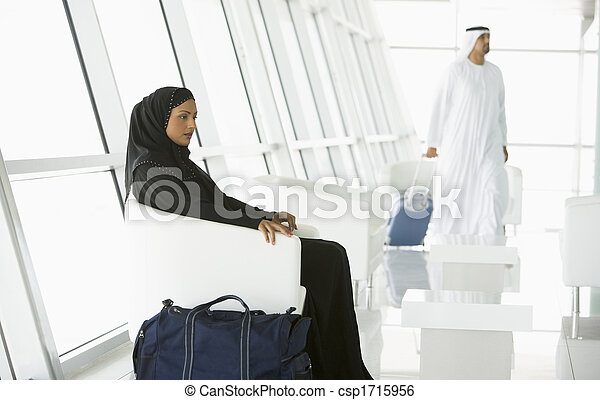 Airline passengers waiting in departure gate - csp1715956
