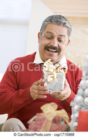 Man Excited To Open Christmas Present - csp1715968