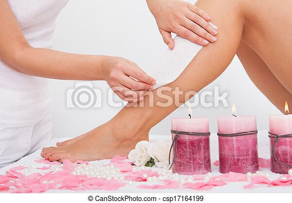Beautician Waxing A Woman's Leg - csp17164199