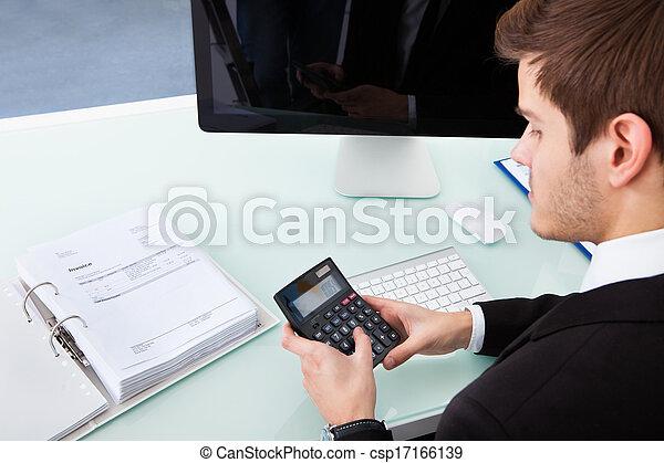 Portrait Of Confident Male Accountant Using Calculator At Desk ...