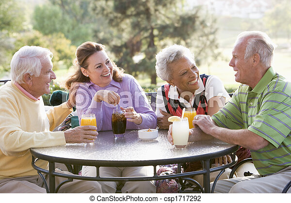 Friends Enjoying A Beverage By A Golf Course - csp1717292