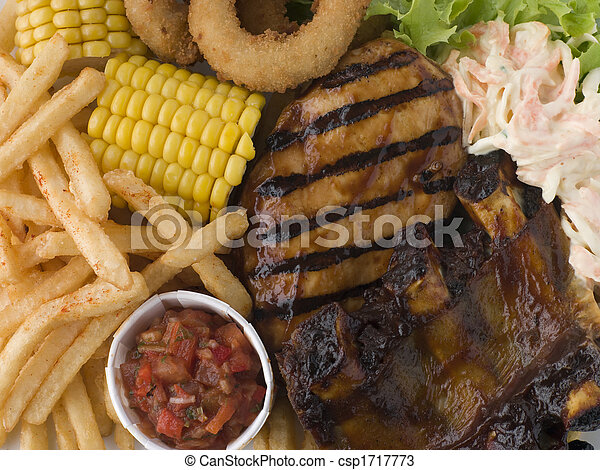 Barbeque Chicken and Ribs with Fries Slaw and Salsa - csp1717773