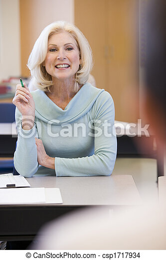 Adult student in class with teacher (selective focus) - csp1717934