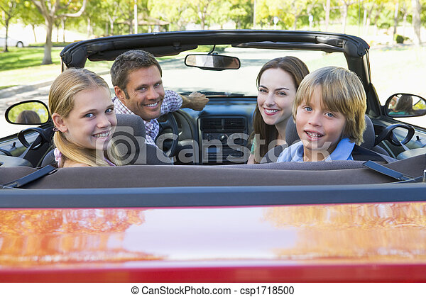 Family in convertible car smiling - csp1718500