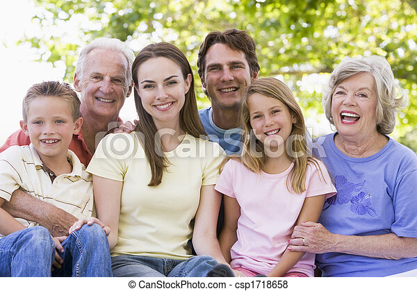 Extended family outdoors smiling - csp1718658
