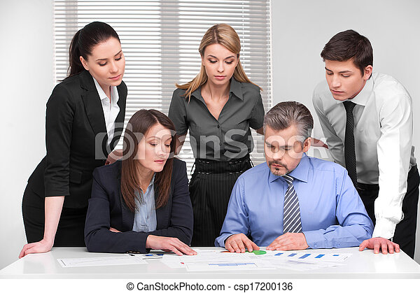 Business meeting  of five business people different age. Discussion and planning in modern light office - csp17200136