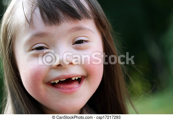 Portrait of beautiful young girl smiling in the park - csp17217293