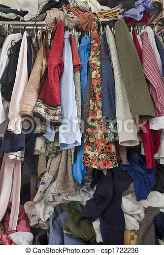 messy closet overfilled with clothes - csp1722236