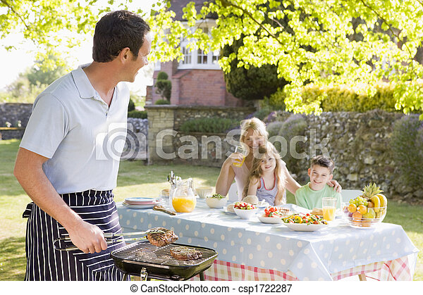 Family Enjoying A Barbeque - csp1722287