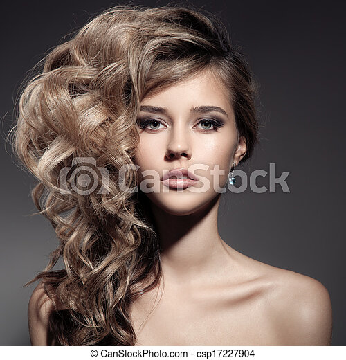 Beautiful Blond Woman. Curly Long Hair - csp17227904