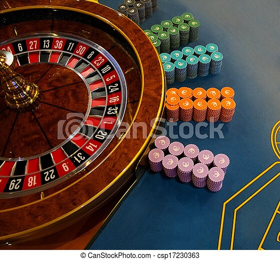 Gambling table with roulette in casino - csp17230363