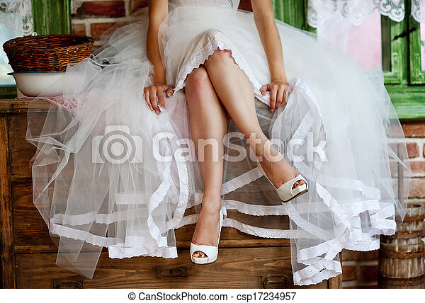 Detail of bridal legs with shoes - csp17234957