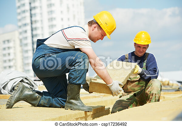 roofer worker installing roof insulation material - csp17236492