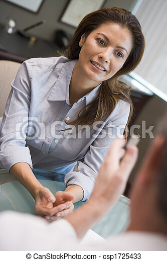 Woman in consultation at IVF clinic (selective focus) - csp1725433
