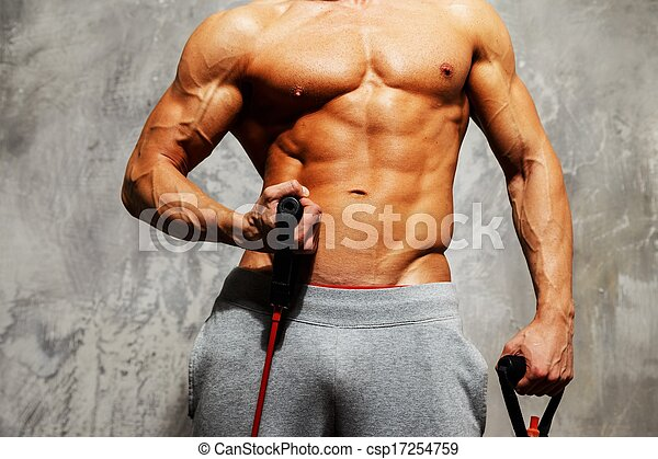 Handsome man with muscular body doing fitness exercise - csp17254759