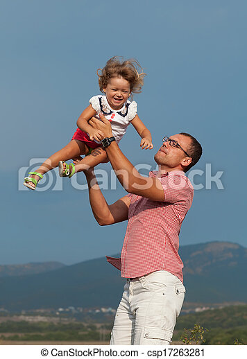 father and daughter playing in the mountains