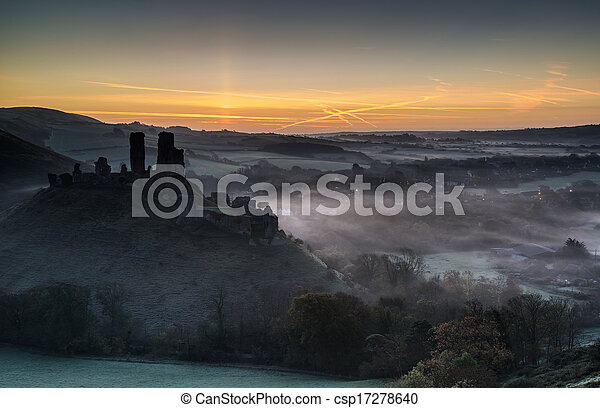 Medieval castle ruins with foggy landscape at sunrise - csp17278640